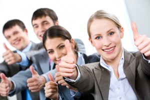 Portrait of business people giving the thumbs-up sign